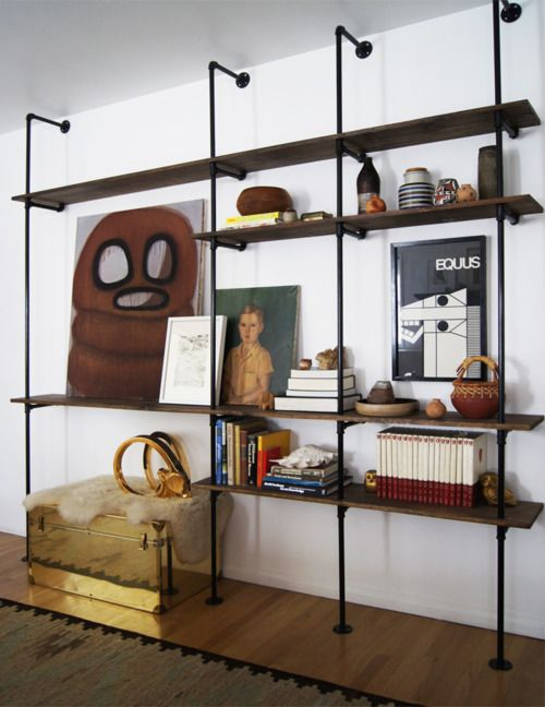 I love any kind of modular shelving, and this one would be great in a loft space. I would likely swap out the lacquered shelves for some raw, reclaimed barn board just to give it more texture, and maybe paint out the pipes to contrast against a bright pop of color on the mounting wall. It would be awesome. Please someone let me come build this in your home. I so want to put this bad boy together!