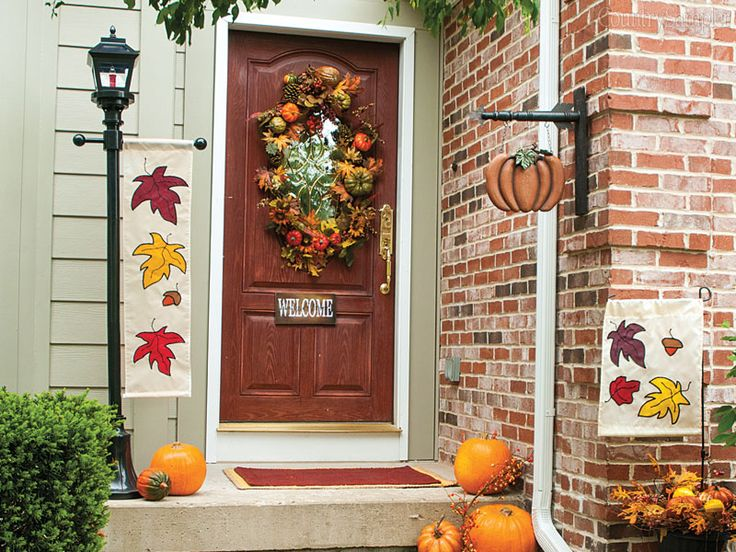 Front-door fall decorating: If you can't find a wreath to fit your front door's window, nail a garland in place around the window's perimeter instead.