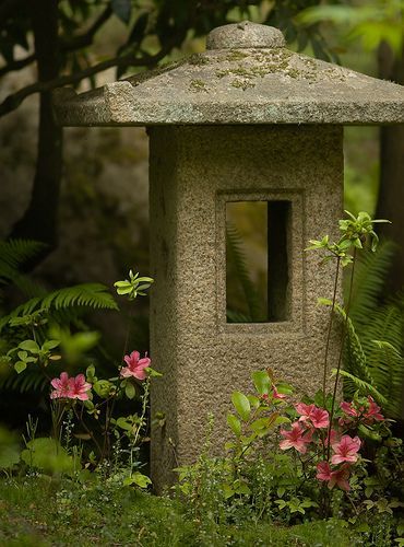 stone lantern Interplanted with living roof on Garage