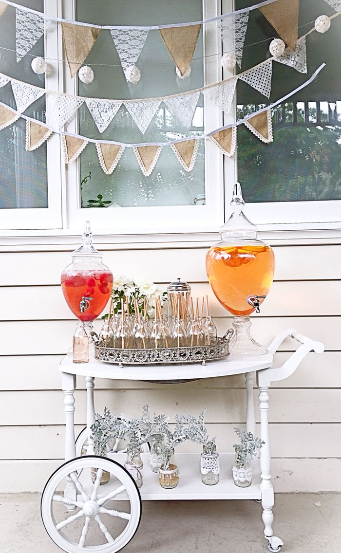 Sweet Vintage drinks cart with out gorgeous drinks dispensers and glass bottles to keep your guests refreshed