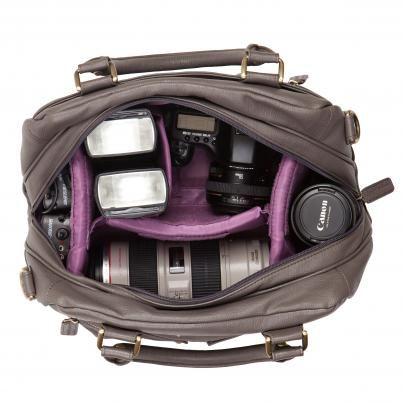 Kelly Moore camera bag. I wouldn't mind a cute camera bag. Not one bit.