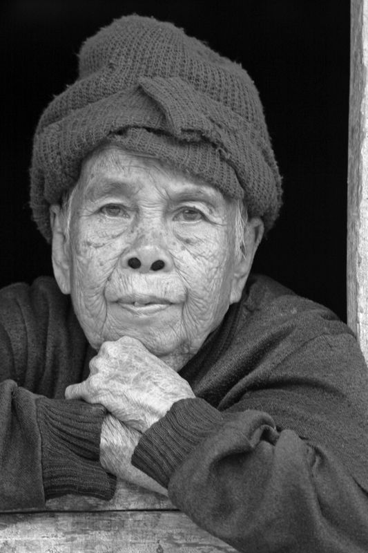 Old lady in Mekong river village, Laos.