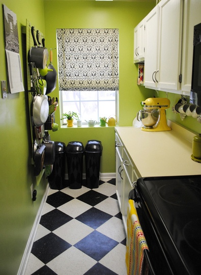 apple green kitchen via kitchn ... I like the idea of hanging classes and having storage for stuff on opposite wall