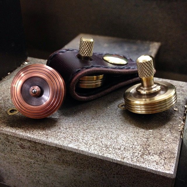 """Check out the new Top Sleeves and four new 1"""" spinning top options on the site. Sleeves are two layers of #horween Chromexcel 100% handmade by @zeebeeleather new copper, brass and bronze tops available to go with. Use the discount code: TOPSLEEVE at checkout for 10% off your order. #pockettoptalk #pockettop #machined #jllawsonco #handmadeleather"""