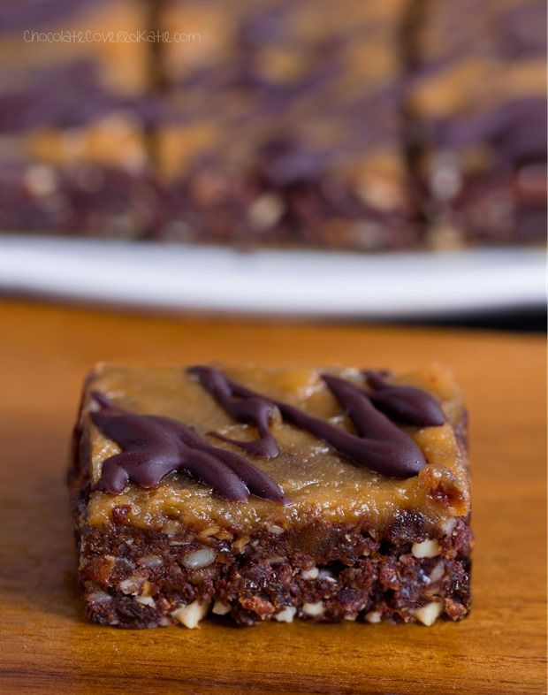Secretly healthy brownie bars - from @choccoveredkt... oil-free, sugar-free, raw, #vegan, paleo, & gluten-free. Full recipe: http://chocolatecoveredkatie.com/2015/06/01/no-bake-chocolate-peanut-butter-brownie-bars/