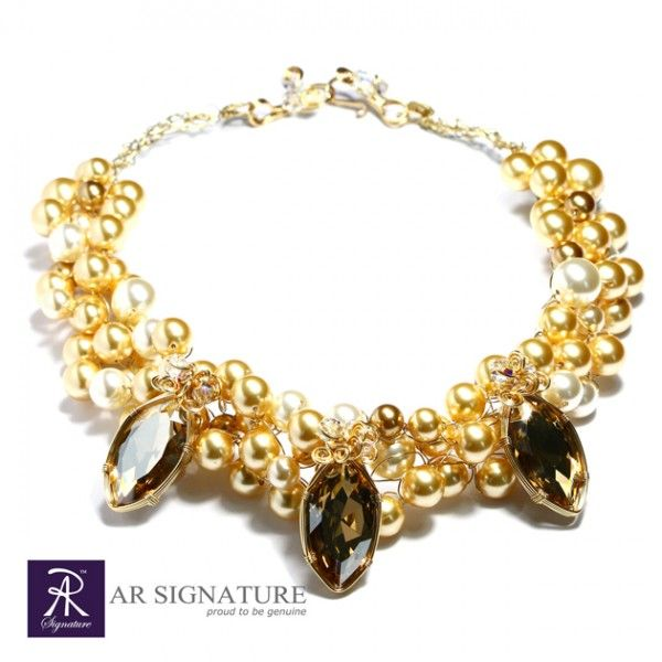 Golden Destiny, Handcrafted by AR Signature using golden shadow crystal from Swarovski®  Specially crafted and combined with gold toned Crystal Pearls and 18K Gold Plated wire from USA to ensure the quality that match the stunning design.  Elegant and luxurius look, perfect for every ballroom party you attend.