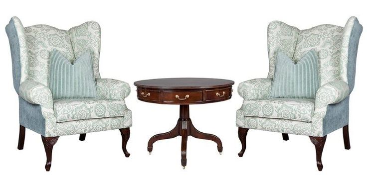 David Llewelyn wingbacks (with signature leg and multiple fabrics) and drum table http://www.dlfurniture.co.za/lounge/chairs