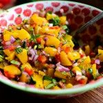 Hmmm, sounds a little unusual (and uses canned peaches surprisingly!), but I'd be willing to try it:  Peach Salsa | The Pioneer Woman Cooks | Ree Drummond