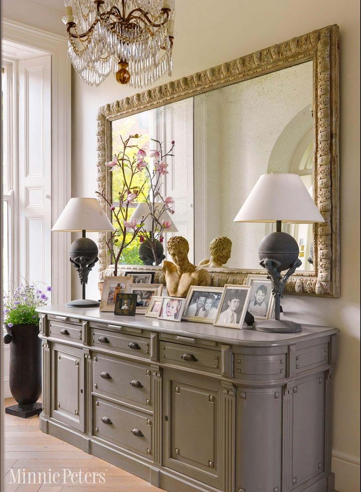 Entrance hall with sideboard and large mirror