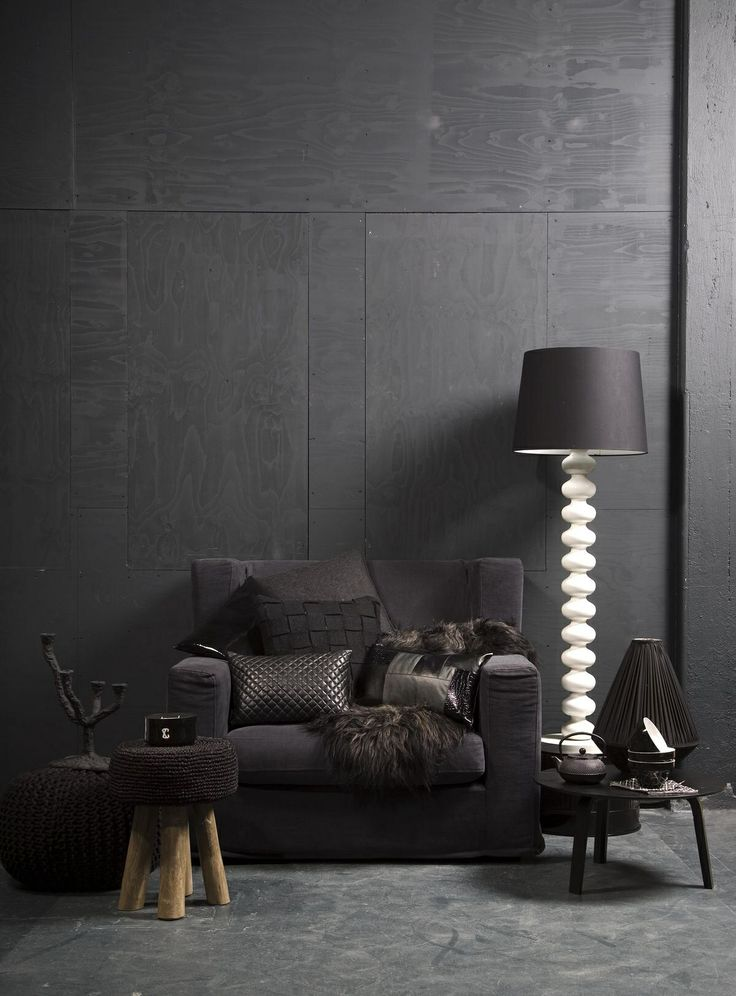 Dark grey plywood wall. Very cool for an accent wall