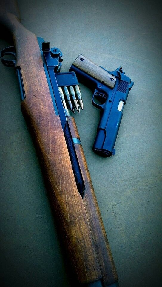 M1 and 1911   Almost makes you feel like you're heading to France to fight Jerry...