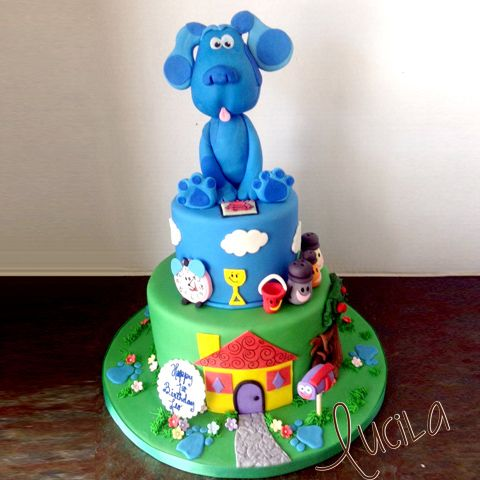 Hand made fondant Blue's Clue on a fondant cake with fondant applications.