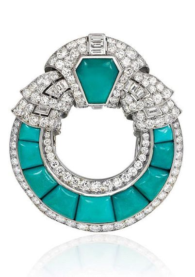 An Art Deco turquoise brooch of open circular design with scrolled diamond top and borders, in platinum. France. Dia. atw 11.04 cts.          Circa:    1925