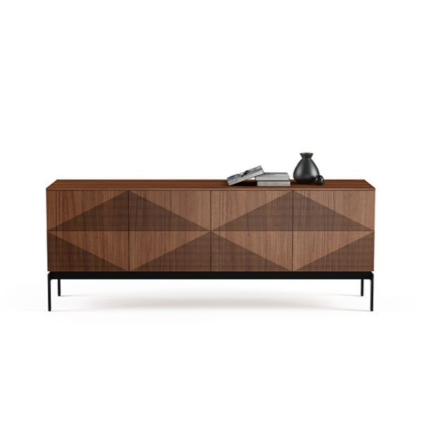 Combining cutting-edge manufacturing with a touch of whimsy, the Zona credenza is an eye-catching design. Deceiving to the eye, the cabinet's doors feature a unique laser-etched diamond pattern that gives the sense of three - dimensionality. Combination of solid and veneer timbers