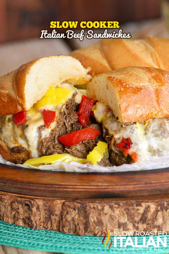 Perfectly seasoned tender slow cooked beef is piled on a toasted bun and topped with ooey gooey cheese and 2 kinds of peppers.  This recipe is so easy you will be pulling out the crock pot over and over to make it this summer. #TSRISummer #slowcooker #crockpot #beef #recipe