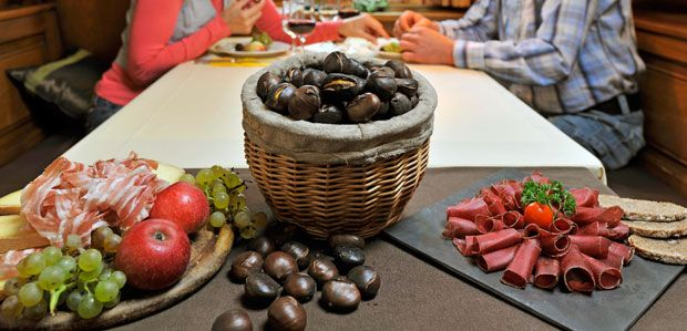 "Mmm... !! ""LA BRISOLÉE"" : "" La brisolée"" is a rustic dish from the Canton of Valais, in Swizerland, which consists of roasted chestnuts served with various accompaniments : cheese, dried meat, autumn fruit ... Every year, the village of Fully organizes a chestnut festival."