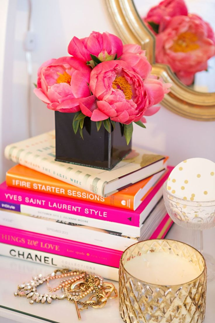 Stacked books and fresh flowers make a gorgeous display. #interior
