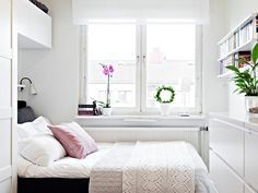 small bedroom - build shelf with light over the bed, curate the windowsill, put table at foot of bed.