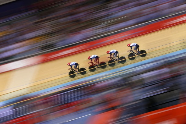 Geraint Thomas, Steven Burke, Edward Clancy, and Peter Kennaugh of Great Britain post a new world-record time during qualifying of the men's team pursuit track cycling event.    Photo: Cameron Spencer/Getty Images