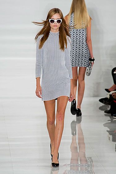 Ralph Lauren Spring 2014 Black and white made a great counterpoint to the reflective white runway — the florals, men's checks and other optics stood out, the best being a tiny-checked mini dress that looked young, fresh and fun.