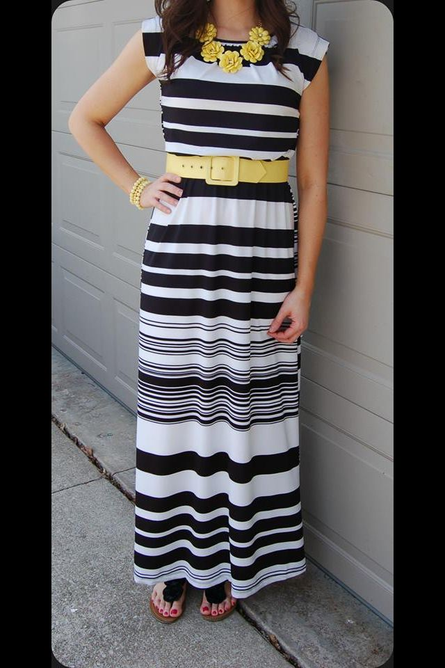 Black and white stripped smack dress, yellow belt and yellow jewelry. Modest spring fashion
