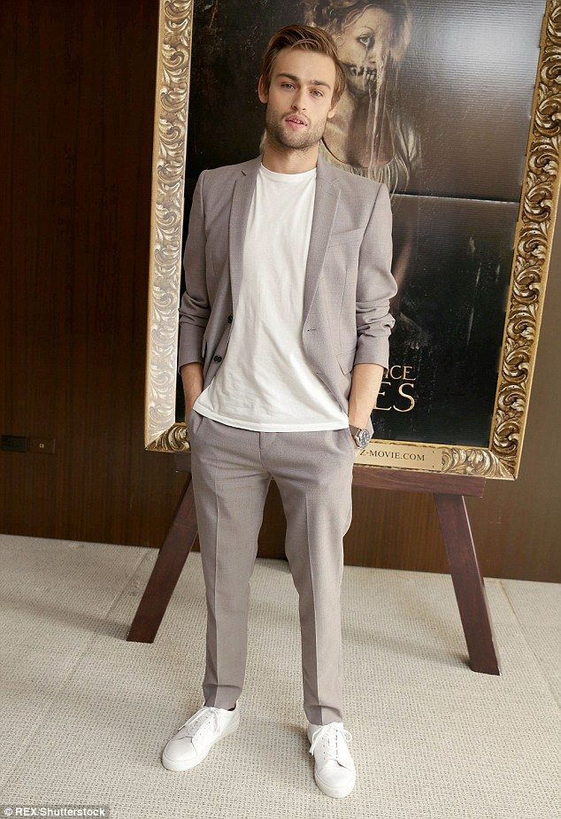 Casual chic: Douglas Booth dressed his suit down with a white tee and matching trainers...