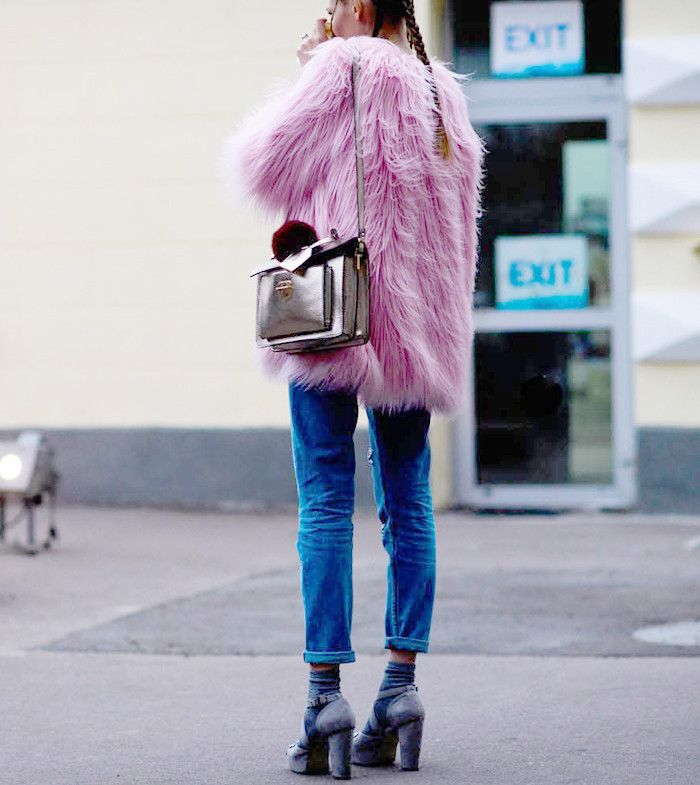 Every fashion girl swears by her furry statement coat, and so should you. See how street style stars are wearing the piece, and shop our favorites here.