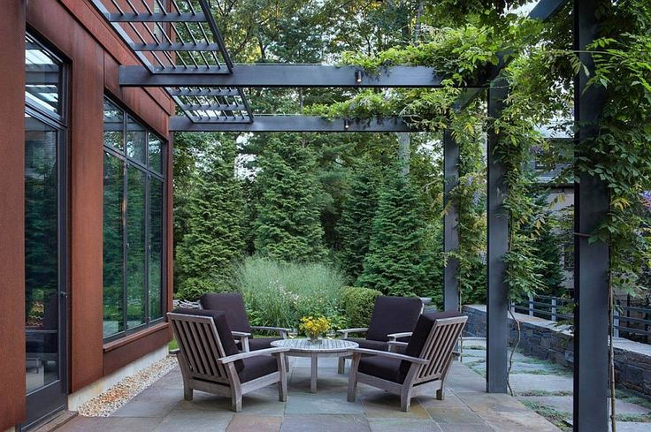 Modern extension to the existong Georgian home comes with a steel pergola structure