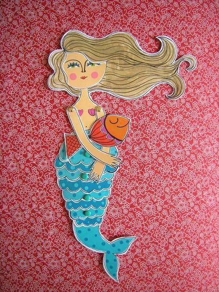 Uma linda sereia e seu peixinho de estimação! <br>A sereia Luna é um ímã articulado, que além de decorar sua geladeira pode ser emoldurado para decorar sua casa como um quadro, além de ser um ótimo marcador de livros :) <br>Ela é impressa em papel 200g