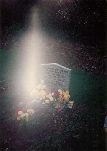 A mother took a picture of her infant son's grave and this is what showed up.