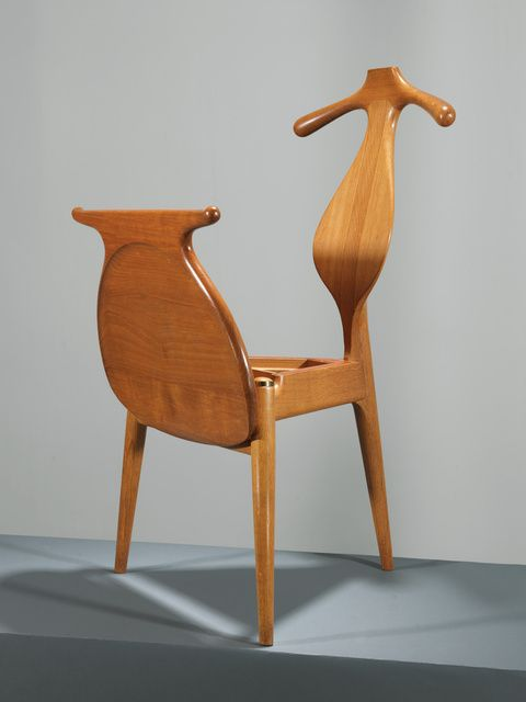 Valet Chair by Hans Wegner. Beautiful piece of furniture, simple and elegant. Made of wood. Perfect for hotel rooms or for bedrooms, its functional as well.