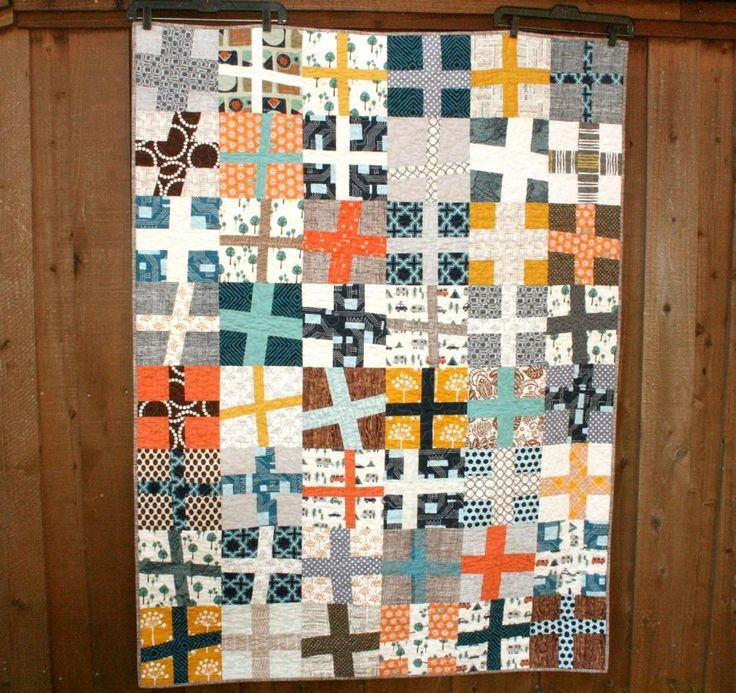 "Fabulous color combinations in this ""Happy Camper Wonky Cross Quilt"" by Quilts by Emily."