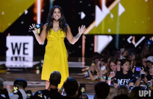 Singer Demi Lovato appears onstage during We Day California at The Forum in Inglewood, California on April 27, 2017. WE Charity, formerly…