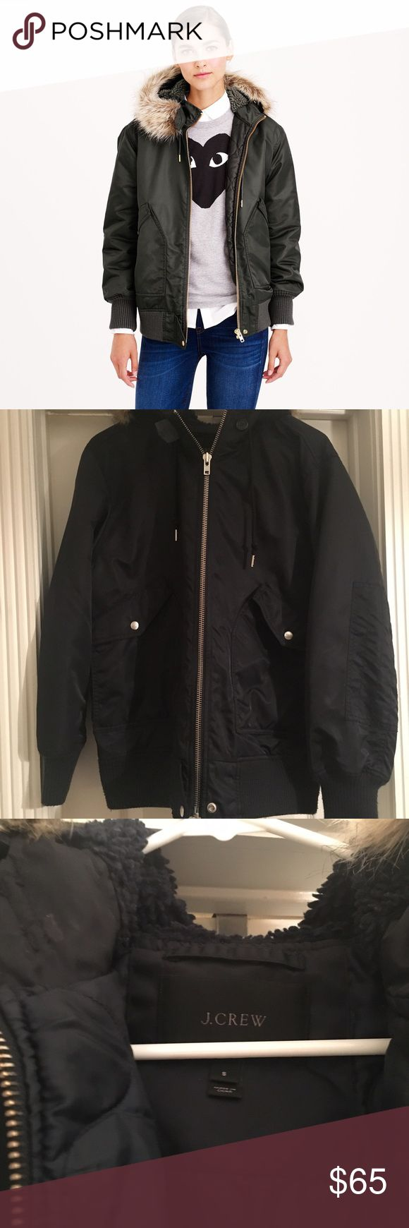 """J. Crew nylon hooded bomber jacket, navy size S Great coat in excellent condition, no visible flaws. Great for warm weather, water resistant. It has an oversized look. Size small, fits like a medium. Would look best on someone taller that 5'4"""". Very high quality bomber jacket. Navy color, detachable fur lining on the hood. J. Crew Jackets & Coats"""