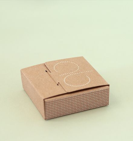 Chic and unusual jewellery packaging for retail, made from recycled board with foil-blocked logo on lid.