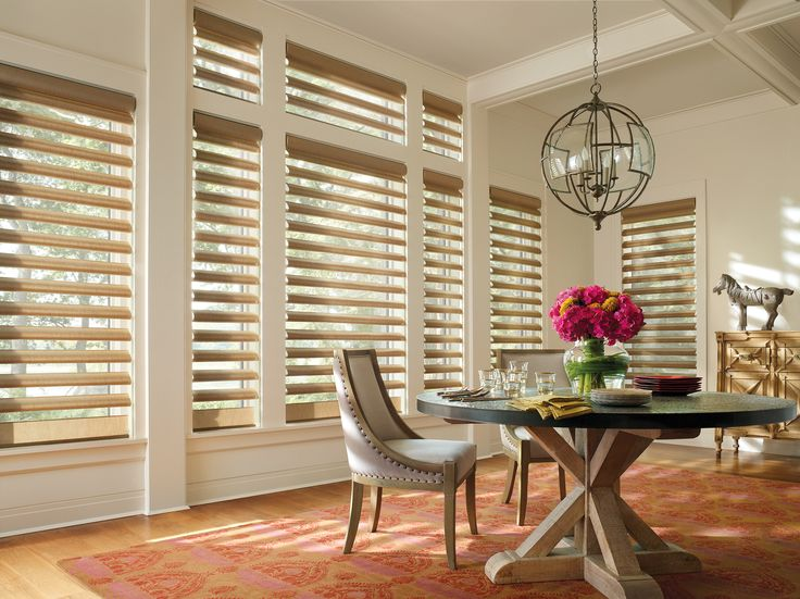 Create a gracious setting for entertaining guests with the light controlling beauty of Alustra® Pirouette® window shadings. ♦ Hunter Douglas window treatments #DiningRoom