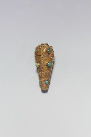 A large Seljuk turquoise-set gold Necklace Fitting Persia, 12th Century of tapering hexagonal cylindrical section, the wider end with faceted edges with domic bosses, the edges with twisted wire enclosing small circles of wire, inset with turquoise 6.1 cm. long Footnotes      For other fittings of this type, see Christie's, Islamic Art and Indian Miniatures and Rugs and Carpets, 15th October 1996, lot 263.
