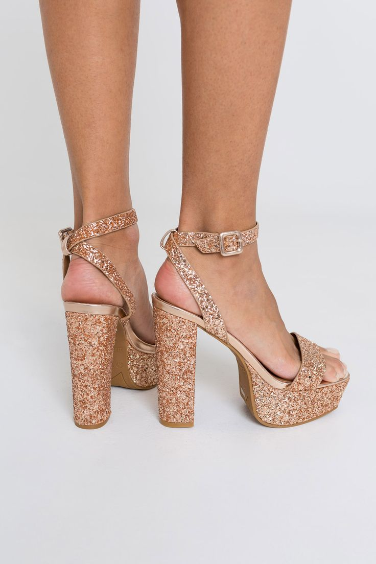 [Ardene] - <p>Platform party shoes. Ankle strap. Open toe. Tall block heel. Cushioned insole. <br/></p>