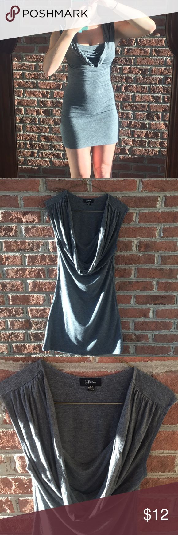 Sexy gray Guess dress size small This tight, comfortable can be dressed up sexy or dressed down casual. Scoop neck very form flattering. Cute for the holidays. Guess Dresses Mini
