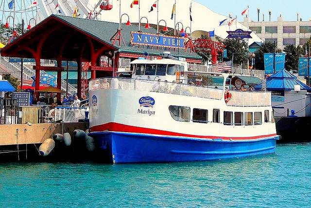 Top things to do at Navy Pier Chicago for kids and adults- top attractions, restaurants, rides, boat cruises, maze and more