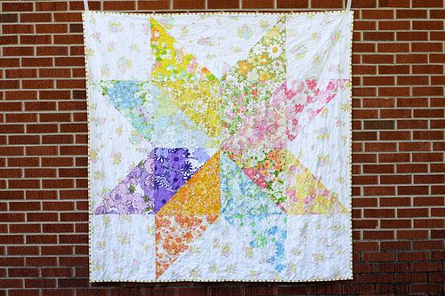 If you like star quilt patterns featuring the popular starflower block, you'll love this super quick Giant Vintage Starflower Quilt. Use big swaths of vintage sheets or reproduction fabrics to make an extra-large starflower.