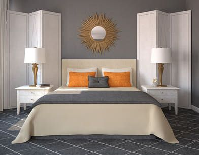 This neutral grey and white room uses orange as its accent. Even though the orange is not used in a significant amount the pillows make a strong statement and create an effective contrast.