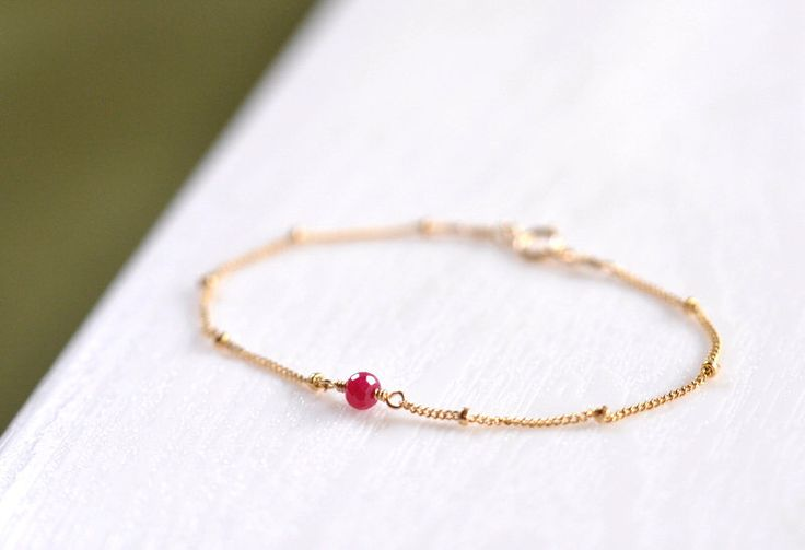 Dainty Ruby Gold Bracelet, Red Ruby Solitaire Bracelet, Delicate and feminine, Minimum Jewelry, everyday jewelry - Fifi LaBonge- by Fifilabonge on Etsy https://www.etsy.com/au/listing/158623343/dainty-ruby-gold-bracelet-red-ruby