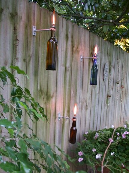 Awesome idea.  I see citronella inside and used for bugs!  So much nicer than cheap bamboo torches