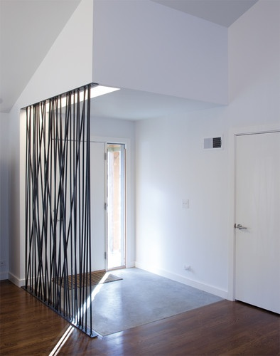 For open-plan ranchers and mid-century modern homes, this screen is a nice alternative to a half-height or full-height wall. Ranch Lite - modern - entry - kansas city - Hufft Projects