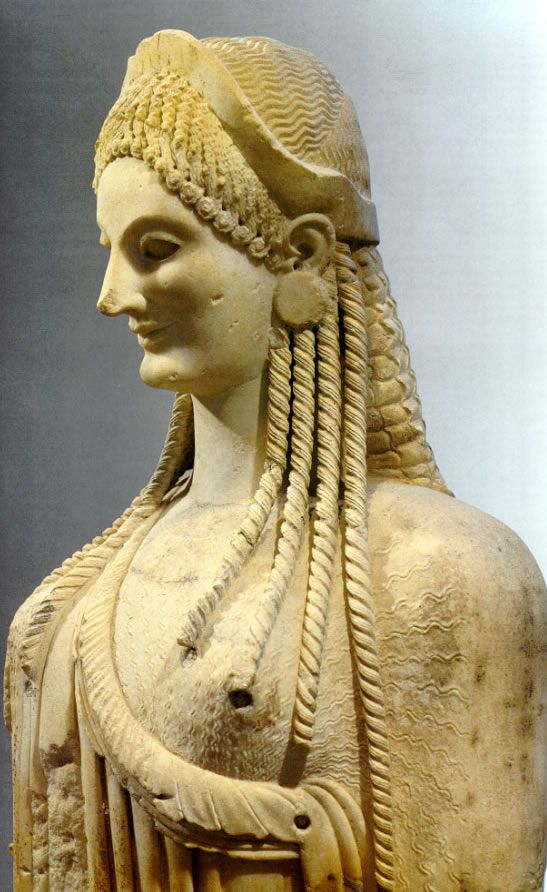 Kore from the Acropolis Archaic period (600 – 480 BCE)    The Kouros and Kore statues were usually lifesize or larger, and made of marble. The kouros (male statue) was always nude and the koure (female statue) was always clothed. The left leg is always forward, the arms are close to the body, touching the side of their thighs. Strict symmetry, simple geometric forms, no individualization.