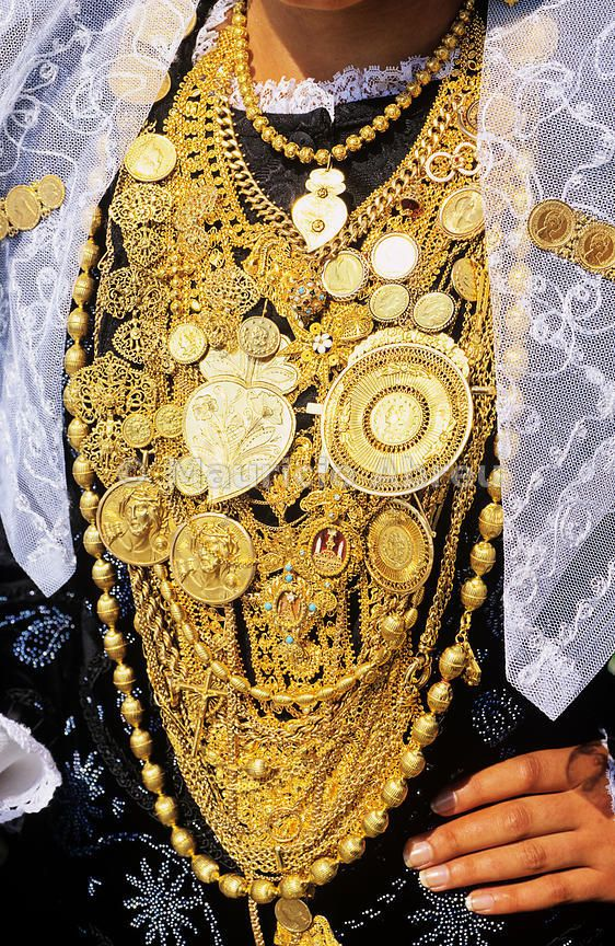 Gold necklaces on traditional black bride's dress. Viana do Castelo, Portugal