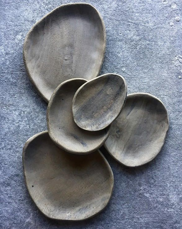 This ceramic dish is part of my Stone Wash collection. It is completely handmade, hand built and is one of a kind. The organic oval shape was made from a slab of white and black porcelain clay marbled together and glazed in a matte clear. Dishes are sold separately. Can make custom order(s).