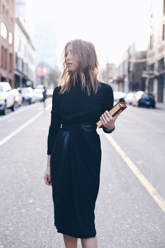 chic black midi dress with a high neck and tousled, textured hair. perfect…
