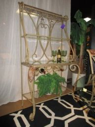 """Transitional style bakers rack in a painted metal. There are three shelves, and it offers glass and bottle storage. Great find! At posting, there is a matching dining set. 43""""wide x 21""""deep x 72""""high."""